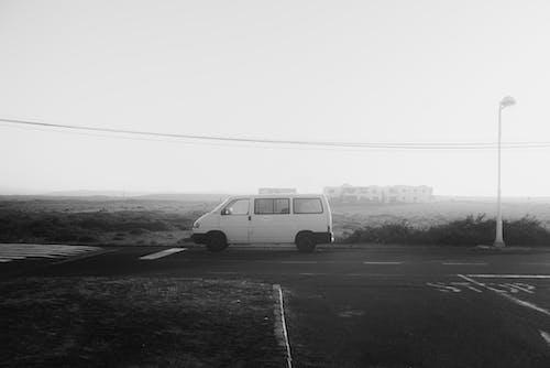 Grayscale Photo Of Van On Road