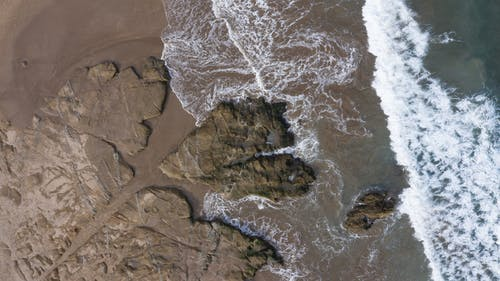 Picturesque rocky seashore with waves