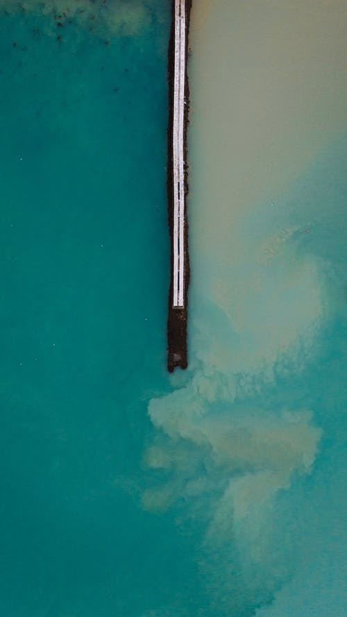 Drone view of pier in blue water