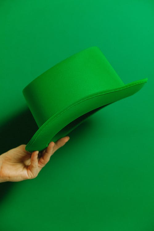 Person Holding Green Hat