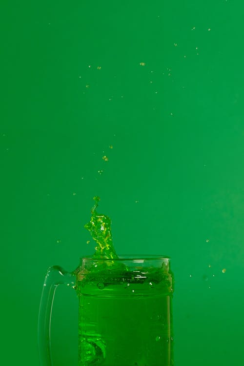 Clear Glass Mug With Green Liquid