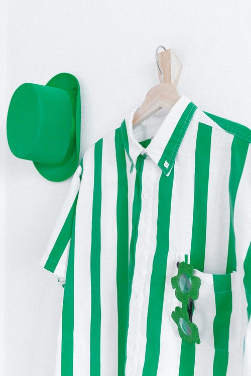 Green and White Striped Shirt and Green Hat