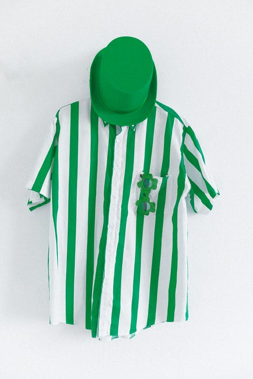 Green Hat and White and Green Striped Shirt