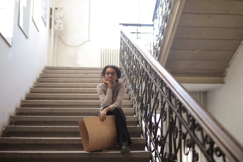 Woman Sitting on Staircase