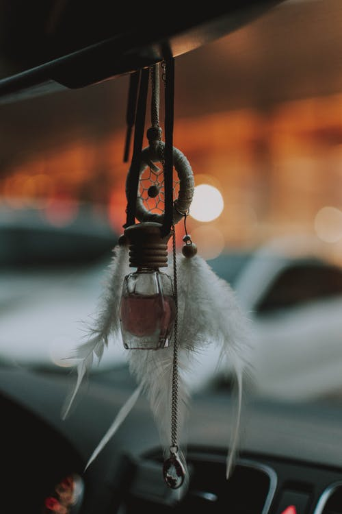 Dream Catcher Hanging On Vehicles Rear View Mirror