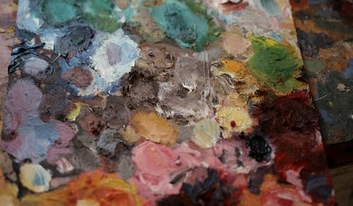 Artists palette with multicolored paints