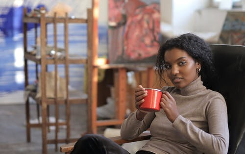 Woman Holding Red Ceramic Mug
