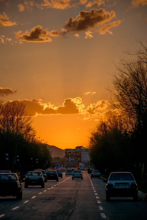 Cars Parked on a the Road During Sunset