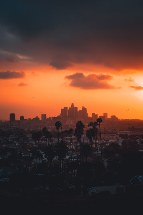 City Skyline Under Orange and Blue Sky
