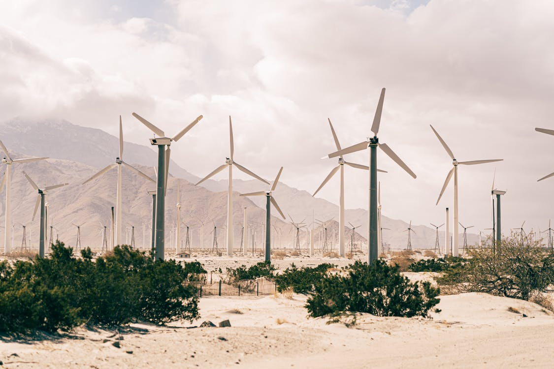 Wind Turbines On Brown Sand