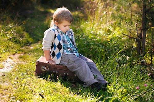 A Boy Sitting on the Grass