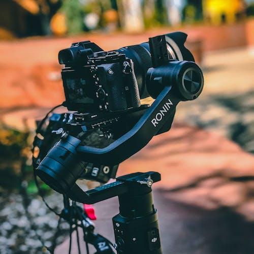 Black Dslr Camera On Gimbal