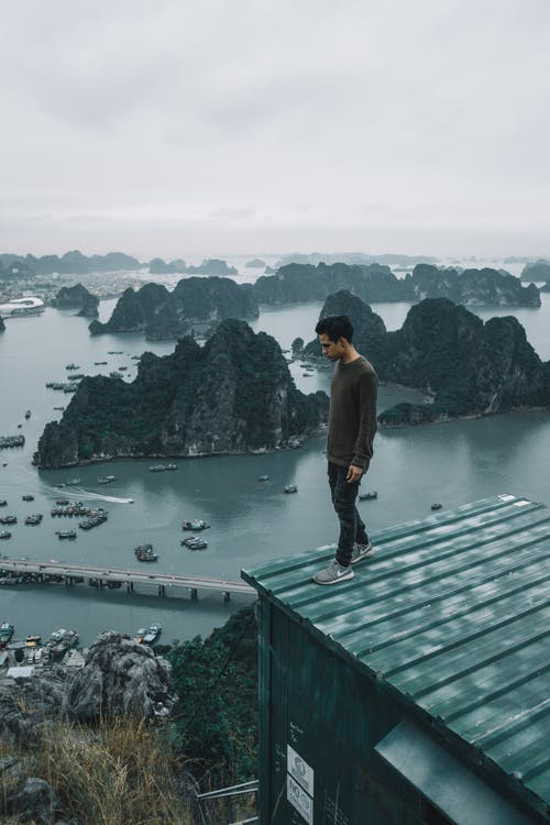A Man Standing on the Roof