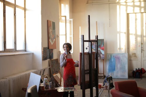 Female artist working on easel in studio