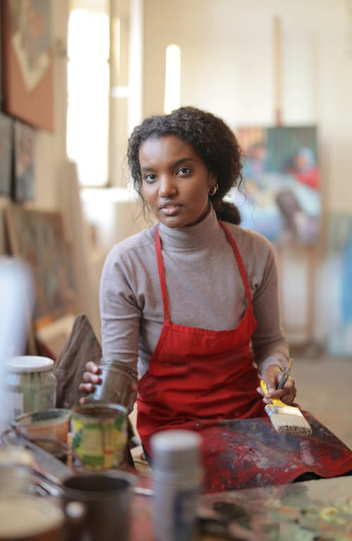 Creative young woman working in workshop