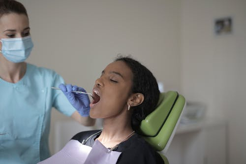 Woman Having Her Teeth Checked