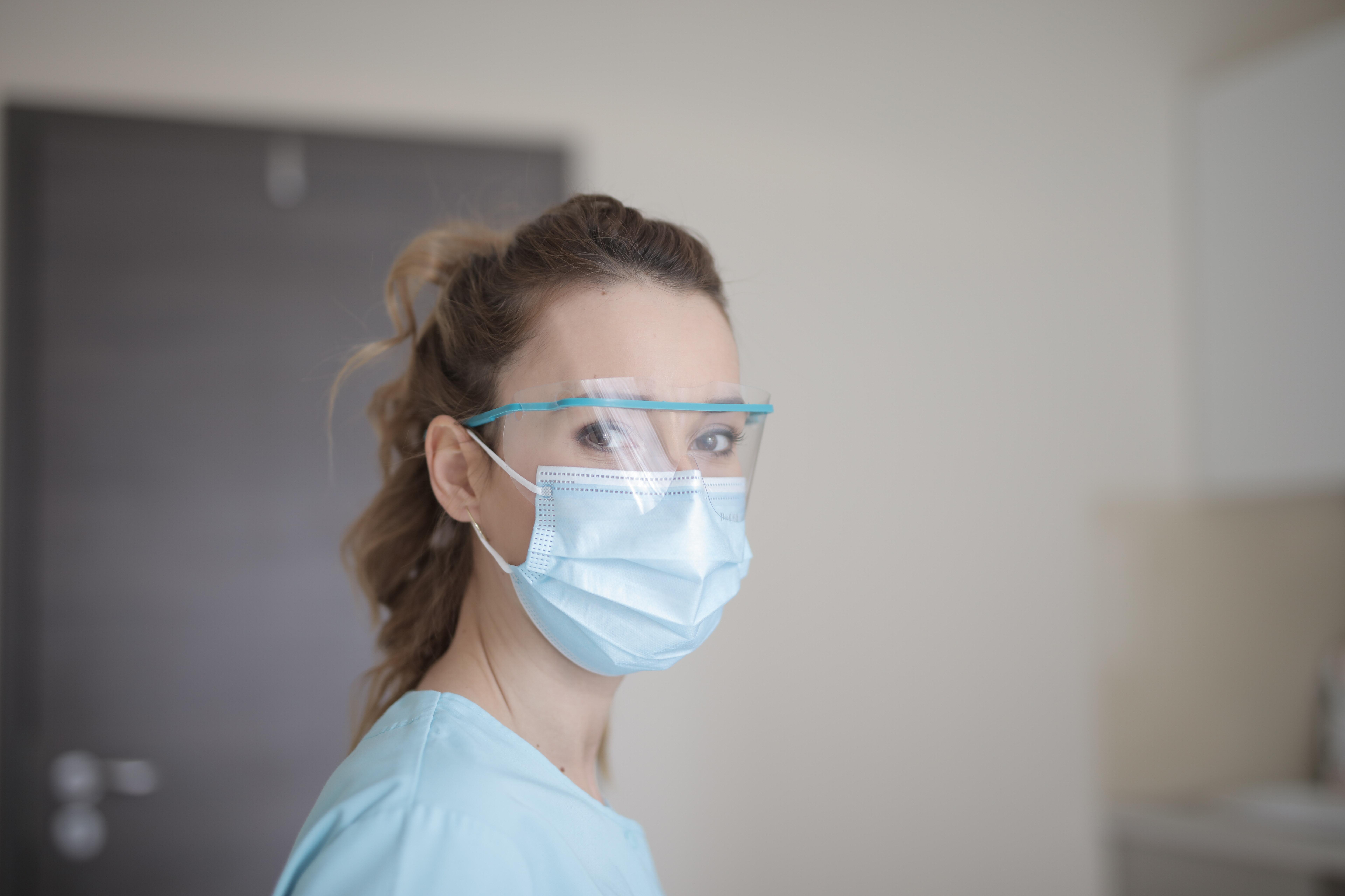 Woman in Blue Shirt Wearing Face Mask - Hotcopy