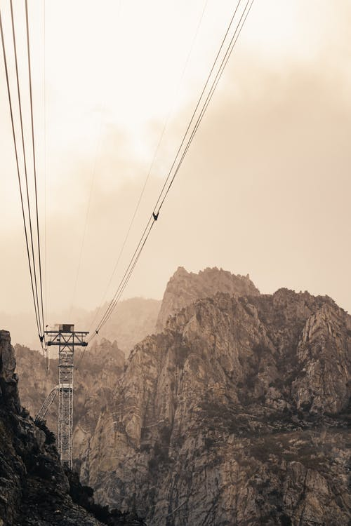 Cable railway among high cliffs on overcast day