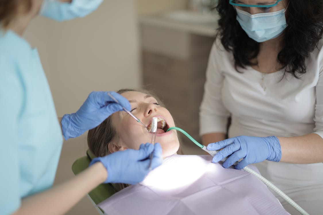 Woman Having Her Teeth Checked By A Dentist