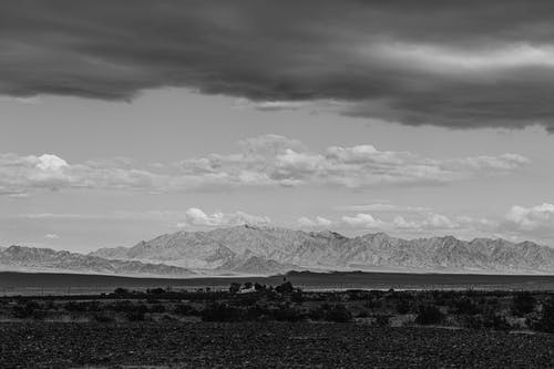 Grayscale Photo Od Mountains