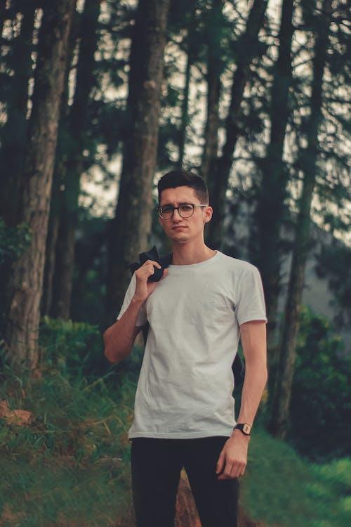 Man In White Crew Neck T-shirt Wearing Black Eyeglasses