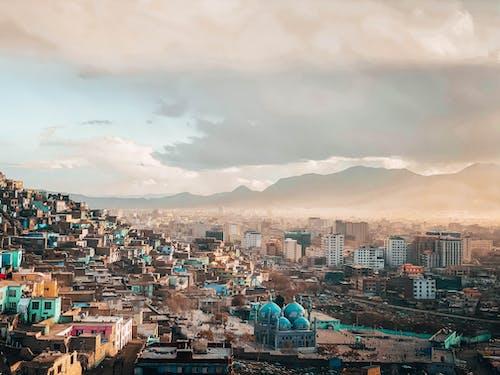 Gratis stockfoto met dageraad, gebouwen, huizen, morgenstond