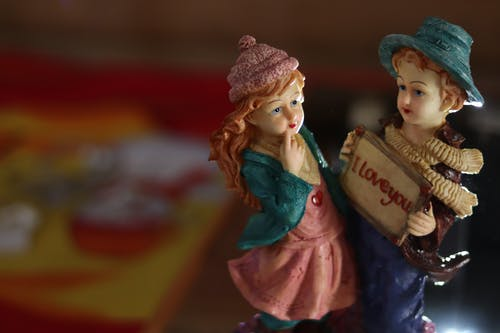 Beautiful handmade porcelain figurine couple with i love you inscription in souvenir shop