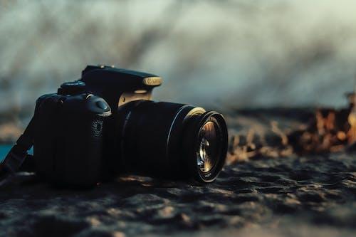 Black Dslr Camera on Ground