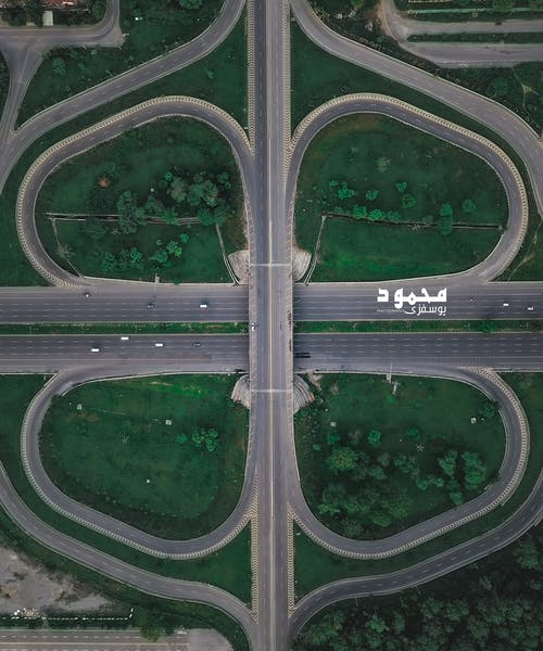 Foto profissional grátis de ciclo, círculo, estrada congestionada
