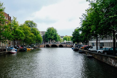 City district with beautiful canal and pedestrian bridge