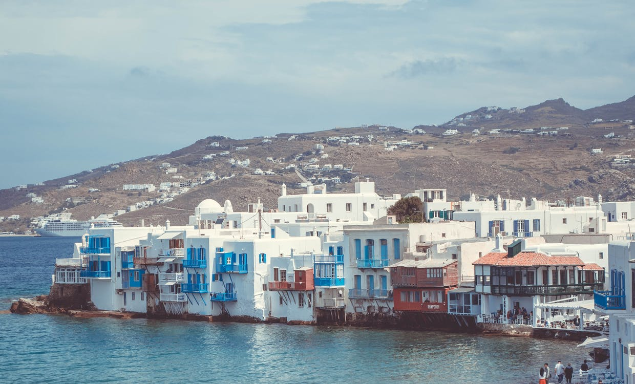 Houses in Between of Mountain and Body of Water