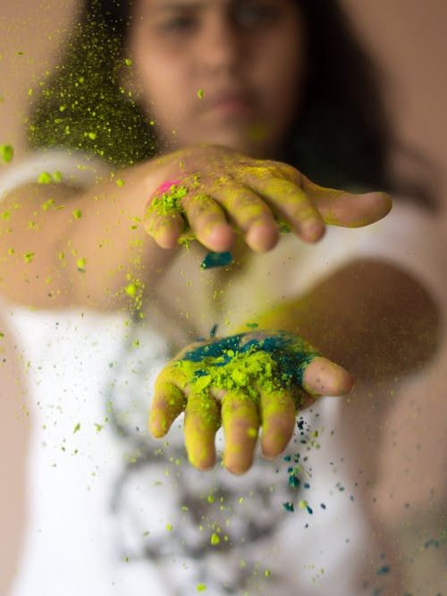 Persons Hand With Green Powder