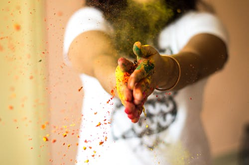 Person With Colored Powder On Her Hands