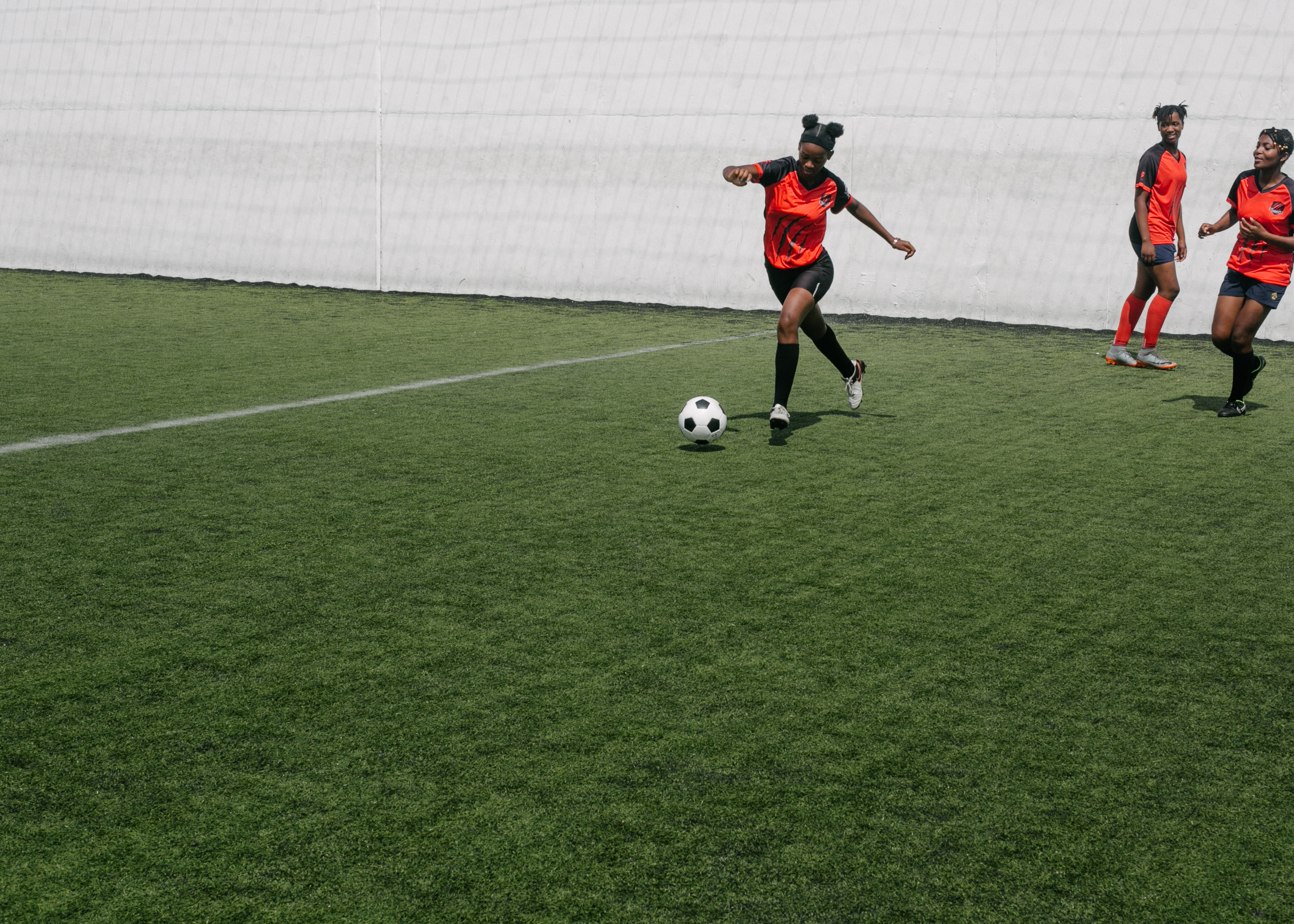 woman kicking ball during football match