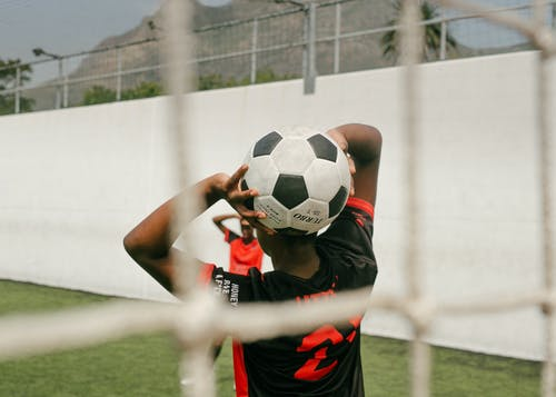 A Player Holding A Soccer Ball