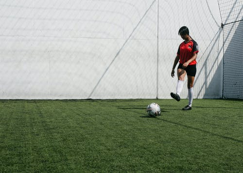 A Goalkeeper Kicking The Ball