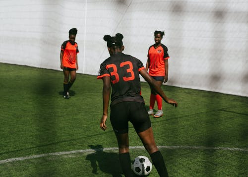 Women playing in soccer on stadium
