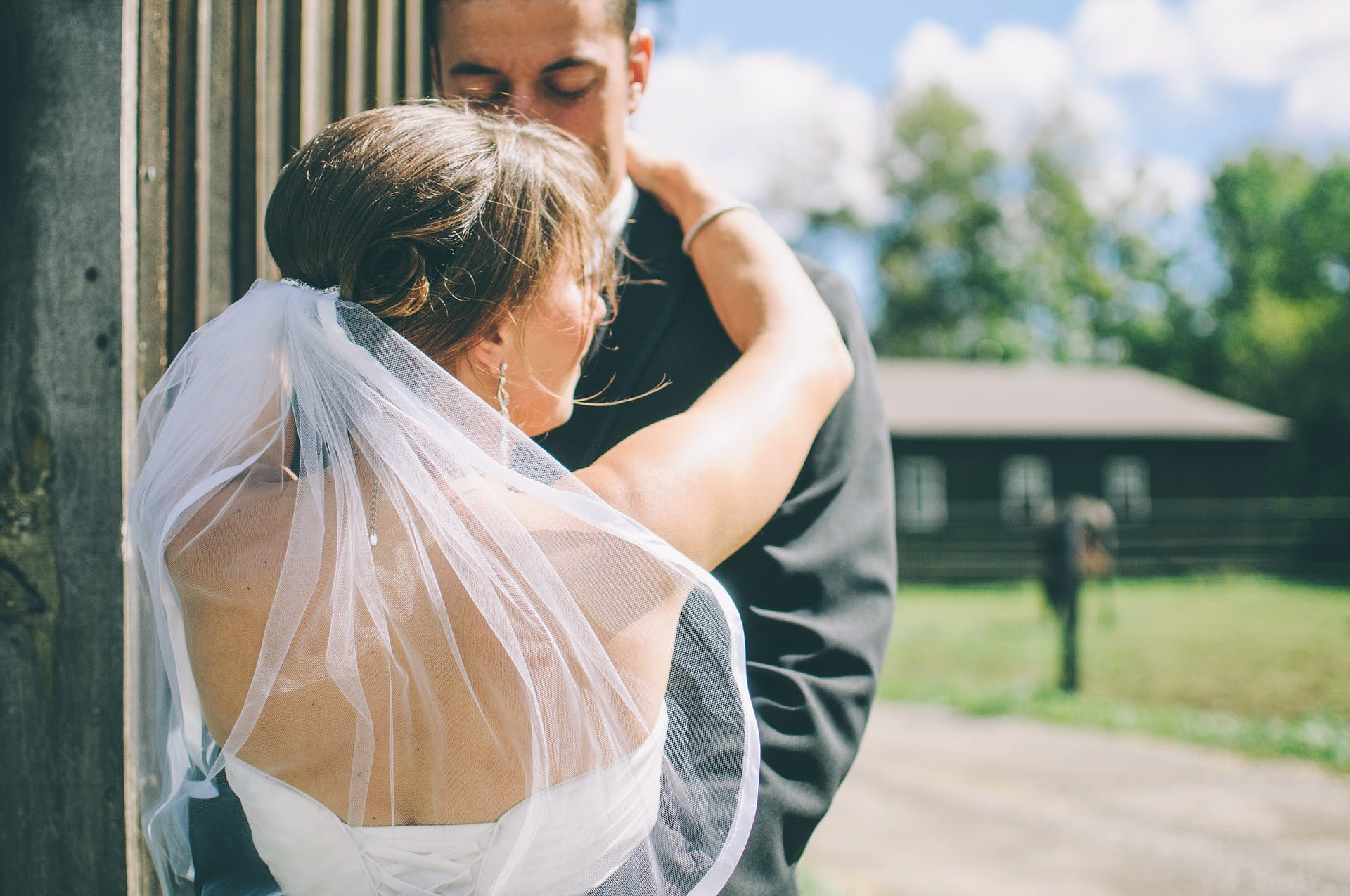 Bride and Groom Hugging Each Other during Daytime