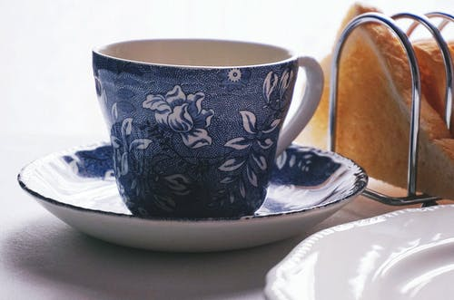 White And Blue Floral Ceramic Teacup On Saucer