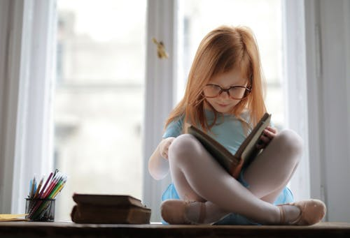 Girl In Blue Dress Reading A Book