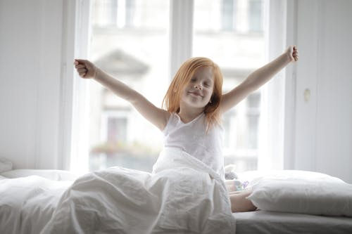 Little Girl Stretching Her Arms