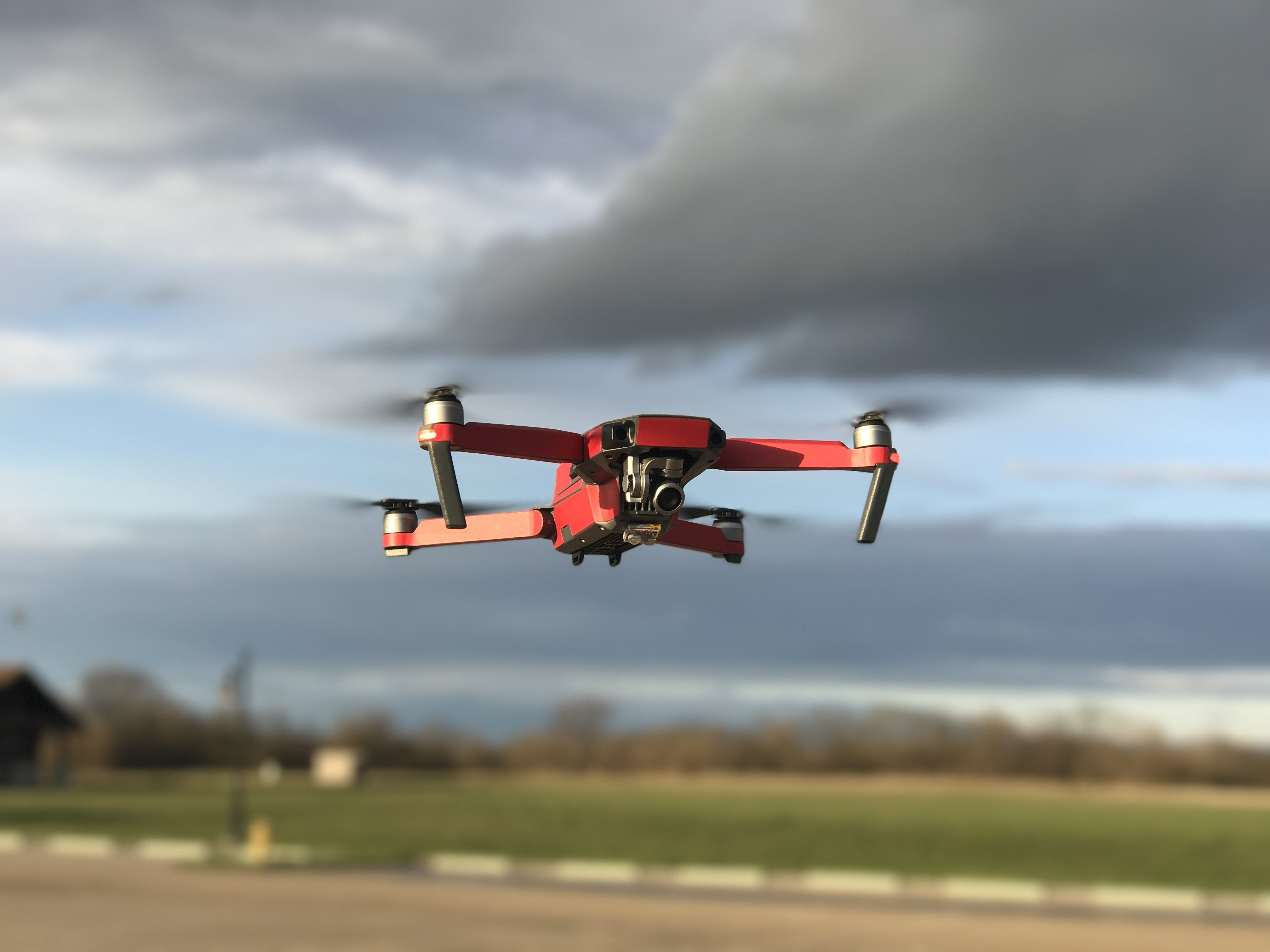Red and White Drone Flying