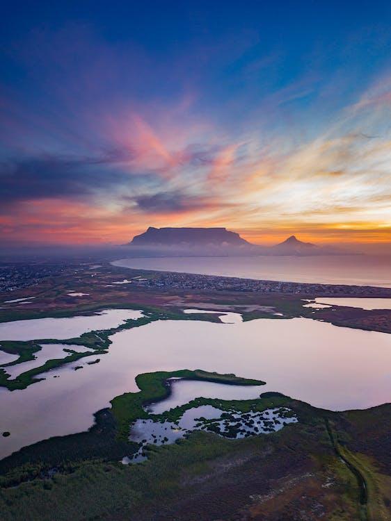 Amazing sunset over mountainous landscape with lakes and coastline