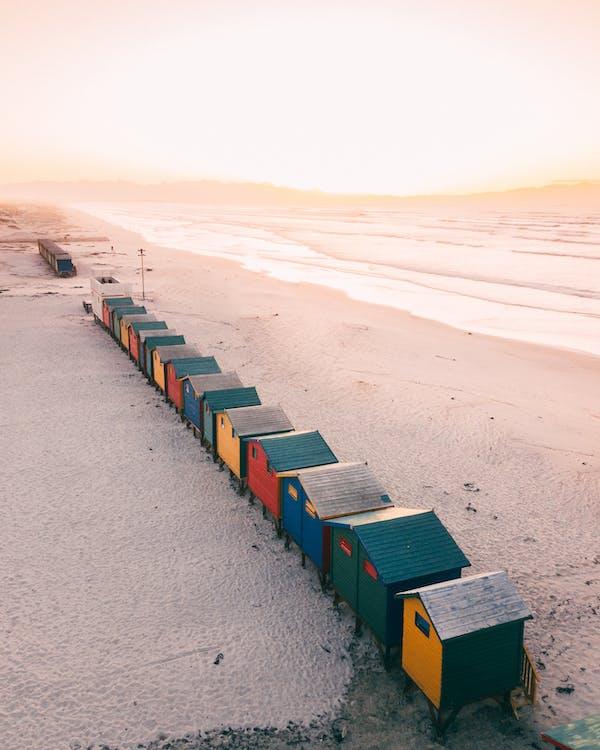 Cozy optimist change rooms on seashore beach in winter