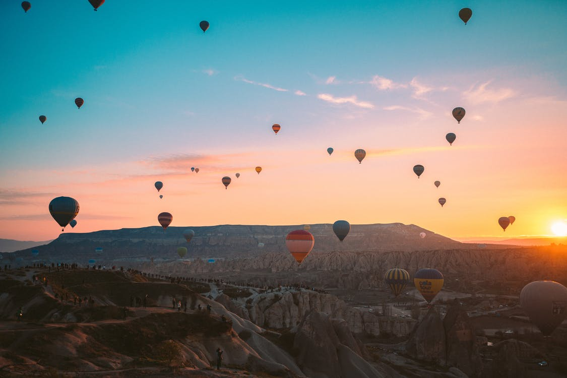 Hot Air Balloons Flying over the Mountains