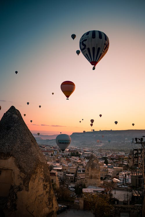 Hot Air Balloons Flying over the City