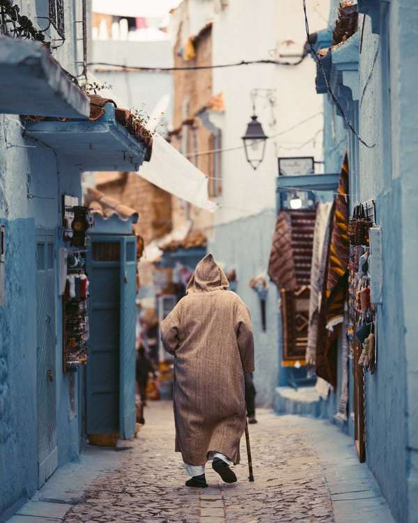 Photo Of Person Walking On Alley