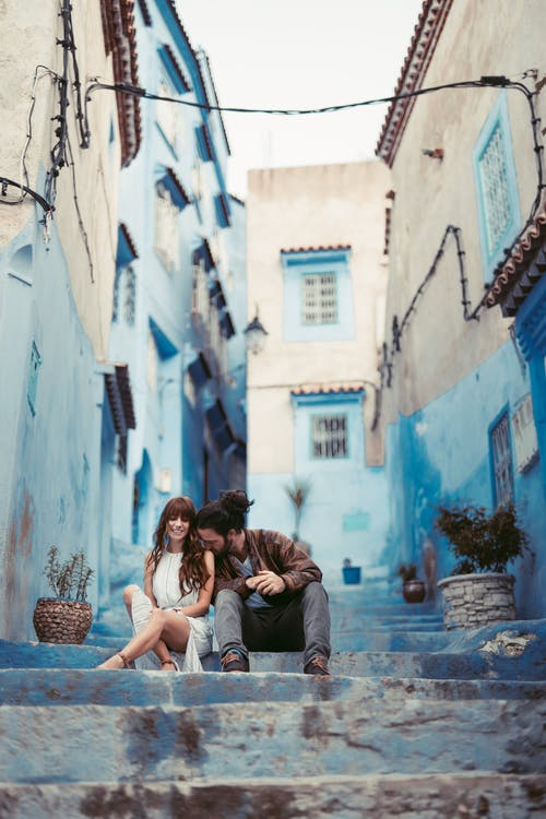 Photo Of Couple Sitting On Stairway