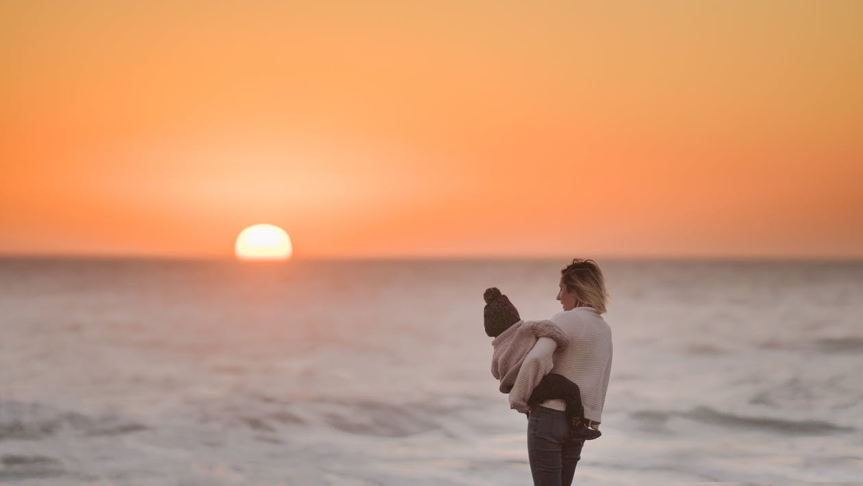 Photo Of Woman Carrying Toddler