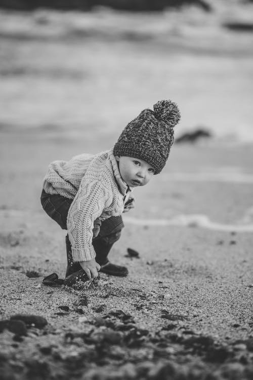 Monochrome Photo Of Child Wearing Knit Sweater